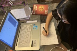 student working on laptop